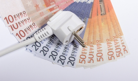 saving electricity: Euro currency and plug. Concept of saving electricity at home.