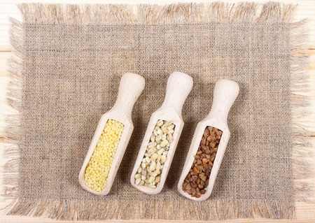 groats: Pearl barley, buckwheat and millet groats on canvas.