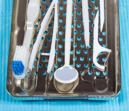 higiene bucal: Disposable dental instruments. The concept of care for oral hygiene. Foto de archivo