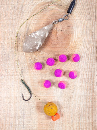 fishing rig: Carp Hook Boilies on wooden background