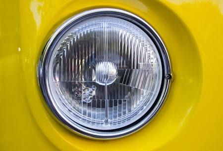 historical reflections: The front side of a retro car with a light .