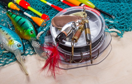 wobler: bait, wobbler and fishing accessories on wooden background Stock Photo