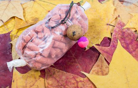 pva: Carp Hook Boilies on a leaf background