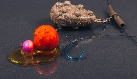 fishing rig: Close Up of Carp Hook Boilies with dip . Stock Photo