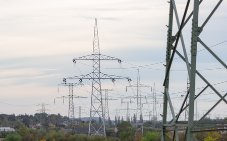 paesaggio industriale: Industrial landscape - a view of the electric poles against the sky. Archivio Fotografico