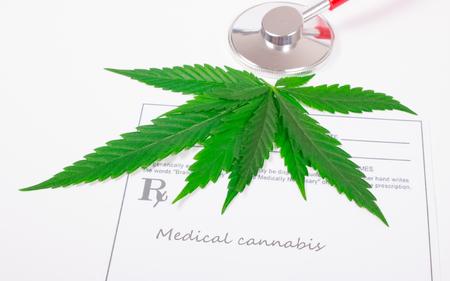 Medical marijuana prescription with stethoscope . CloseUp.