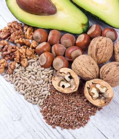 linseed: Sources of omega 3 fatty acids: flaxseeds, avocado, walnuts and sunflower. Stock Photo