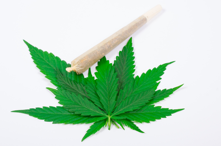 spliff: Marijuana with joint (spliff) . The concept of therapeutic marijuana. Stock Photo