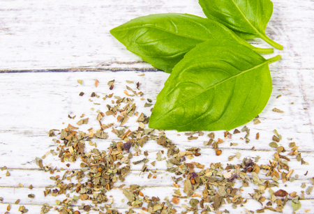 crushing: Fresh and dried basil, herbs and spices. Healthy eating concept.