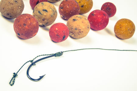 fishing rig: Close Up of Carp Hook Boilies isolated on white background .
