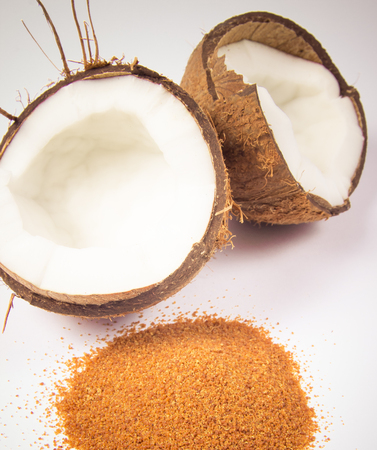 sugar palm: CloseUp on a coconut with coconut sugar isolated on white background.