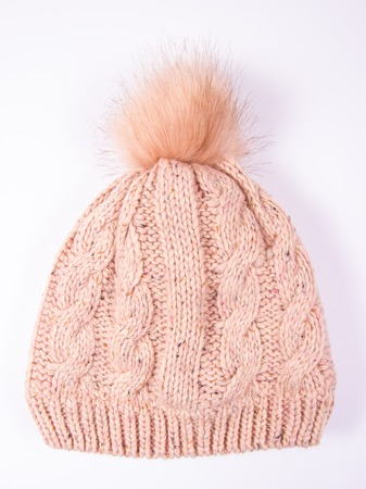 Womens woolen hat for winter weather on a white background. Close Up.