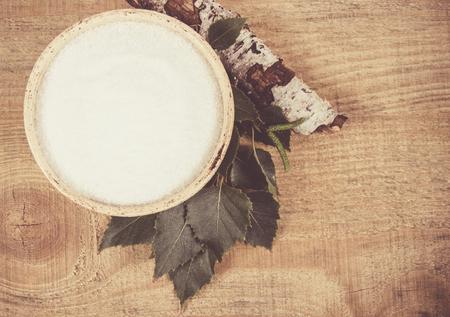 Xylitol - sugar substitute for diabetics. Birch sugar on wooden background.