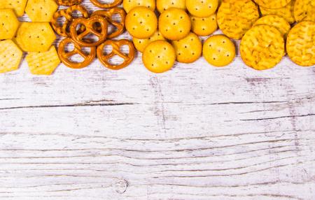 Mix of snacks : pretzels, crackers, cookies. Close Up. Stock Photo