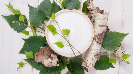 Xylitol - sugar substitute for diabetics. Birch sugar on white wooden background. 스톡 콘텐츠