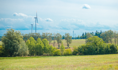 View of the landscape with windmills - renewable energy generators.