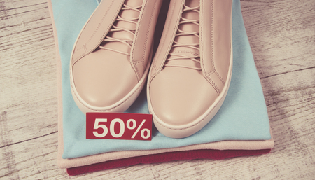Female clothes on light background. Fashion womens accessories and wear. The concept of great shopping.