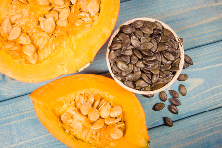 Raw pumpkins on the blue wooden background. Stock Photo