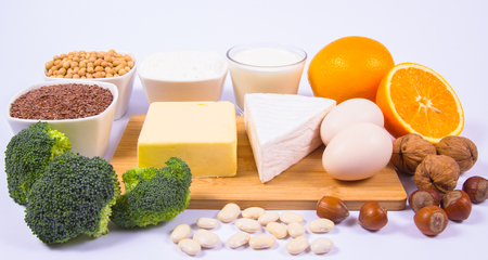 The ingredients contain a large amount of calcium. The concept of a healthy diet. White background. 版權商用圖片