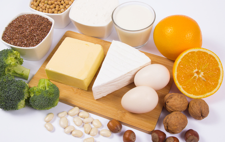 The ingredients contain a large amount of calcium. The concept of a healthy diet. White background. Banco de Imagens