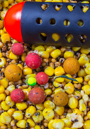 Bait rocket carp fishing. Carp anglers seeking to prebait effectively. This Bait Rocket can be used to throw a large quantity of seeds or boilies precisely.
