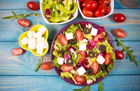 Conception of healthy eating. Fresh vegetable salad with feta cheese. Imagens