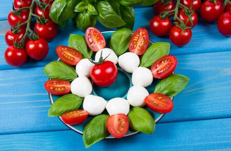 Caprese salad with tomato and mozzarella, italian food of mediterranean diet, weight loss concept. 写真素材
