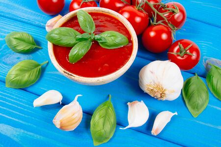 Sauce from fresh tomatoes with garlic and basil. The concept of a healthy diet.