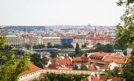 Prague - the capital of the Czech Republic. Panorama of the city, landscape view with red roofs.