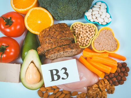 Nutritious ingredients and products containing vitamin B3 (PP, niacin) and other natural minerals, concept of healthy lifestyle and nutrition. Isolated on white.