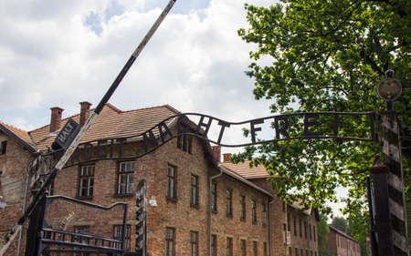 Auschwitz-Birkenau, Poland - June 27, 2019 The inscription ,, Arbeit macht frei ,, of the German concentration camp Auschwitz.