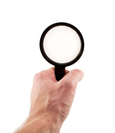 magnifying glass in hand on a white background