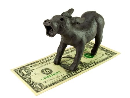plasticine donkey standing on the dollar Stock Photo