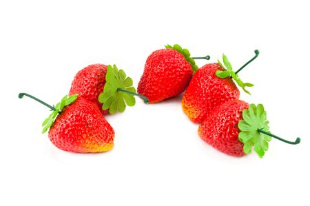 artificial strawberries on white background