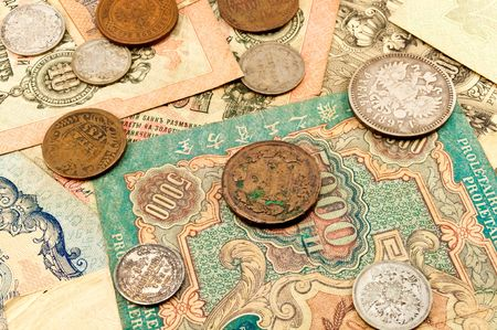 The old banknotes and coins Stock Photo