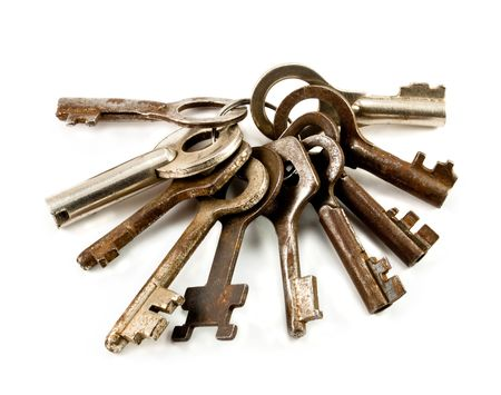 a bunch of old rusty keys on a white background