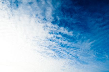 blue sky background with light clouds on the horizon Stock Photo