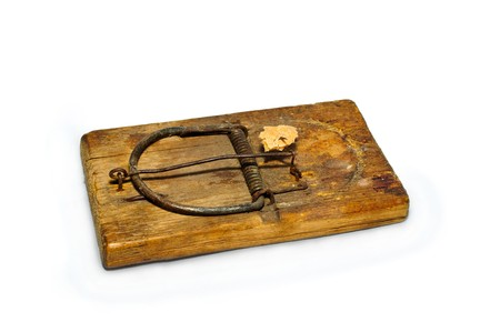 old mousetrap with bait on a white background photo