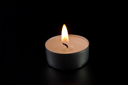alight: alight candle on black background