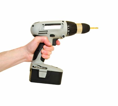 Cordless screwdriver in hand on a white background