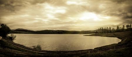 Dark landscape  Dramatic sky, lake, mountains Stock Photo