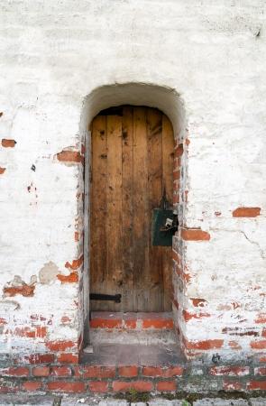 old door and brick wall