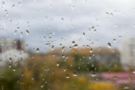 raindrops on glass closeup, background