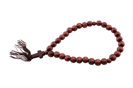 wooden rosary with a cross on a white background