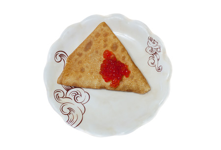 pancake with red caviar on a plate