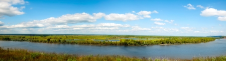 summer panorama of river and sky with clouds Stock Photo