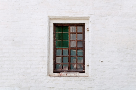 old window with iron grating, brick wall