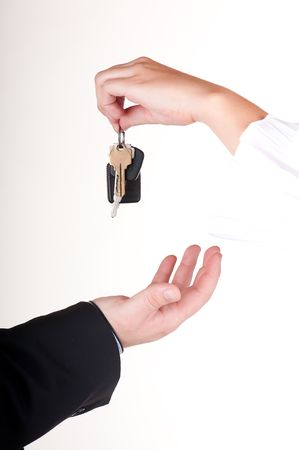 Man is getting a key to his new car from a woman photo