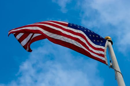 American flag on windy day with cloudy sky as a background Stock Photo - 5340414