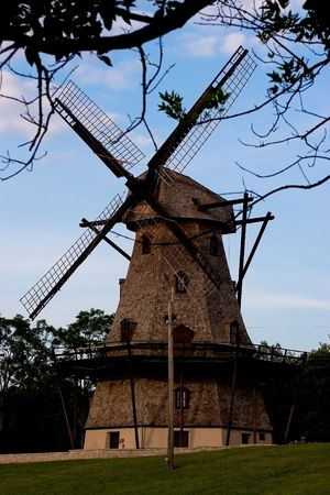 Old windmill located somewhere in the park in Illinois photo